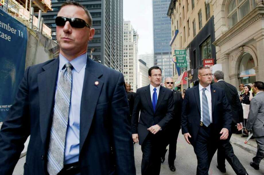 Gov. Dannel P. Malloy leaves Ground Zero accompanied by his security detail after President Obama lead a tribute to the victims of the Sept. 11, 2001 terrorist attacks at the World Trade Center in New York City on May 5, 2011. Photo: Kathleen O'Rourke / Stamford Advocate