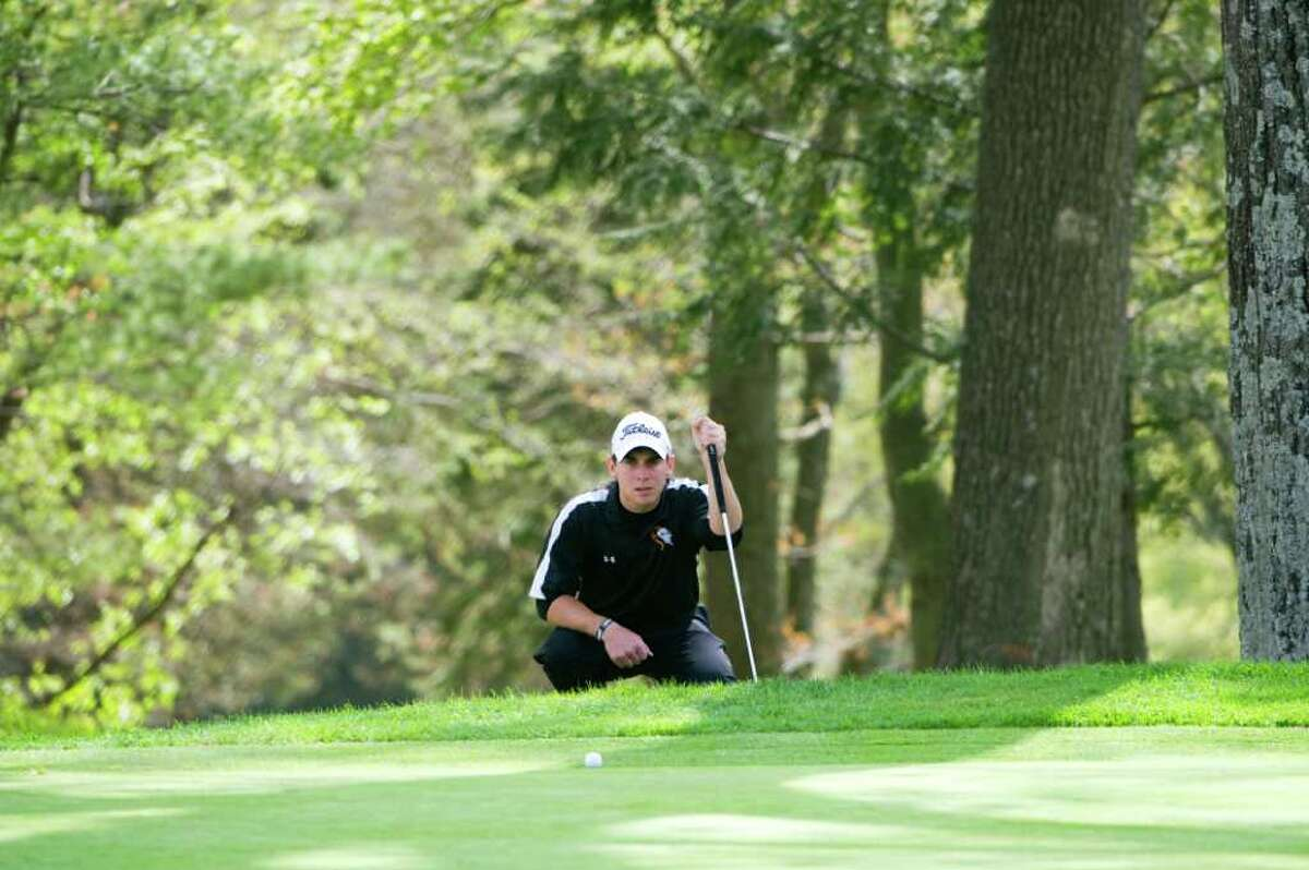 Stamford High's Chad Weissman works his way around the course during the Stamford City Golf championship at Woodway Country Club in Stamford, Conn., May 5, 2011. Stamford, Westhill and Trinity Catholic High Schools all played.