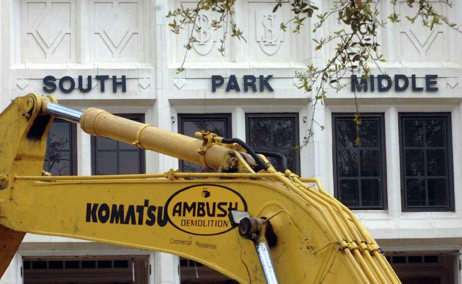 "In a bit of irony, since some people consider the demoltion of the former South Park Middle School to be an ambush, a front-end loader marked ""Ambush Demolition"" demolishes the school front entrance in April 2010. Enteprise file photo Photo: Pete Churton"