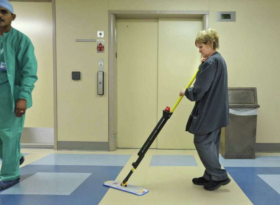 Housekeeping staffer Linda Anderson, of Schenectady, uses a new micro fiber mop at Ellis Hospital in Schenectady, N.Y. Thursday May 5, 2011. (Lori Van Buren / Times Union) Photo: Lori Van Buren