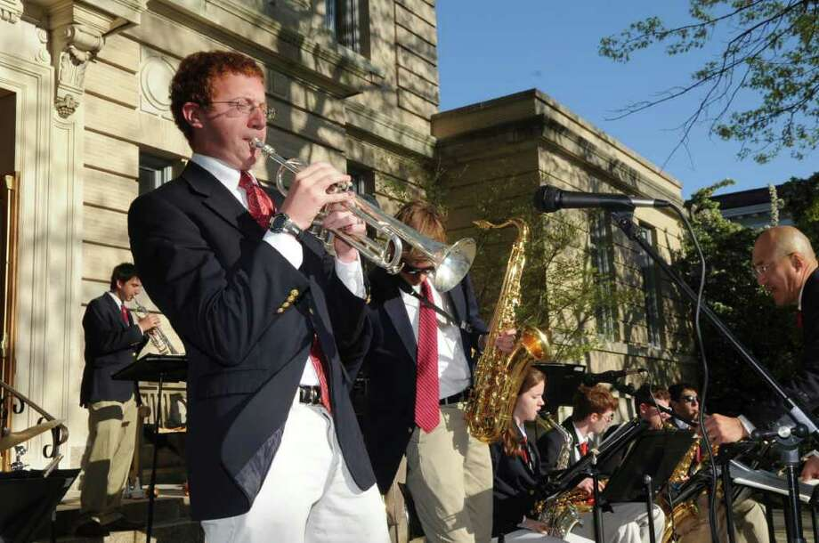 Warren Bein, a junior at Greenwich High School, plays a solo on his trumpet with the school's jazz ensemble at the opening night festivities of Art to the Avenue on Thursday, May 5, 2001. Photo: Helen Neafsey / Greenwich Time