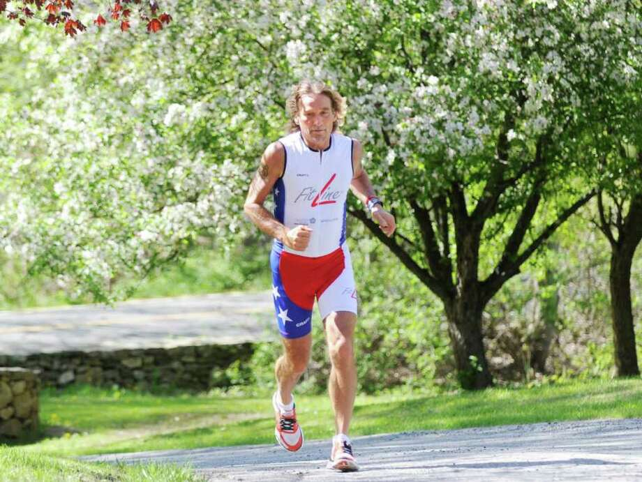 Ultra runner Achim Heukemes of Hagnau, Germany, trains on upper Riversville Road, Greenwich, Thursday afternoon, May 5, 2011.  Heukemes is planning to cross the American continent twice starting on June 25 by biking to San Diego and then by running back, finishing his race at Ground Zero on Sept. 11, 2011 to commemorate the 10th anniversary of the Sept. 11 terrorist attacks. Photo: Bob Luckey / Greenwich Time