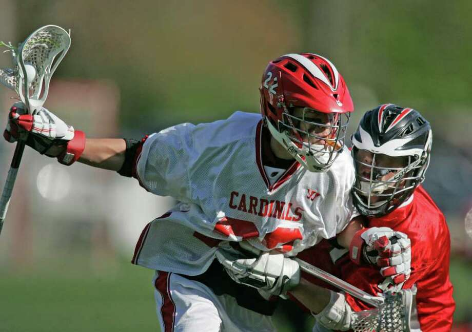 Greenwich High School middie Alex Moeser runs through a Fairfield Prep body check in route advancing the ball as Greenwich downed Fairfield Prep. Greenwich is now 6-4 on the year. Photo: J. Gregory Raymond / Stamford Advocate Freelance