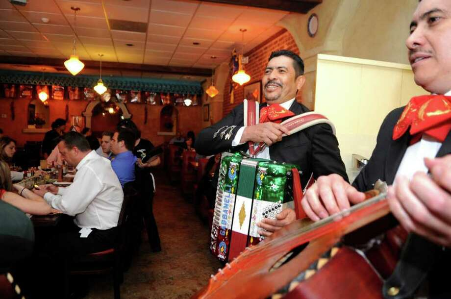 Mariachi musicians from Las Strellas de America, Raul Beltran, left and his brother Juan play on Cinco de Mayo at MaryAnn's in Stamford on Thursday, May 5, 2011. Photo: Helen Neafsey / Greenwich Time