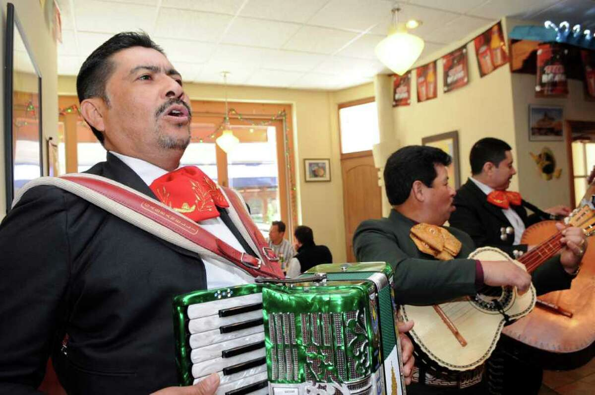 Mariachi musicians from Las Strellas de America, Raul Beltran, left, Carlos Palma (leader) and Beltran's brother Juan play on Cinco de Mayo at MaryAnn's in Stamford on Thursday May 5, 2011.