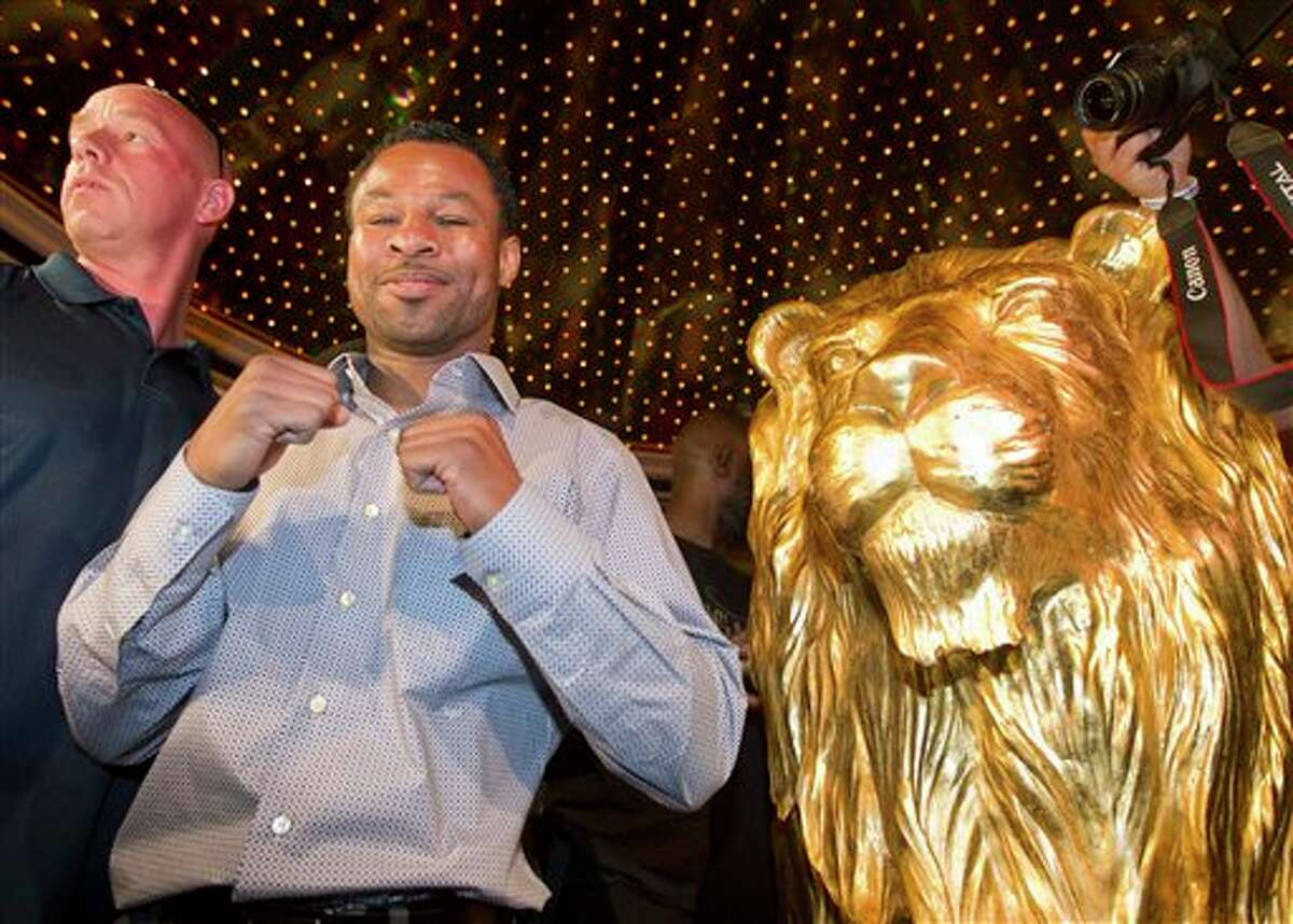 Shane Mosley poses for photos after arriving at the MGM Grand in Las Vegas on Tuesday. JULIE JACOBSON/ASSOCIATED PRESS