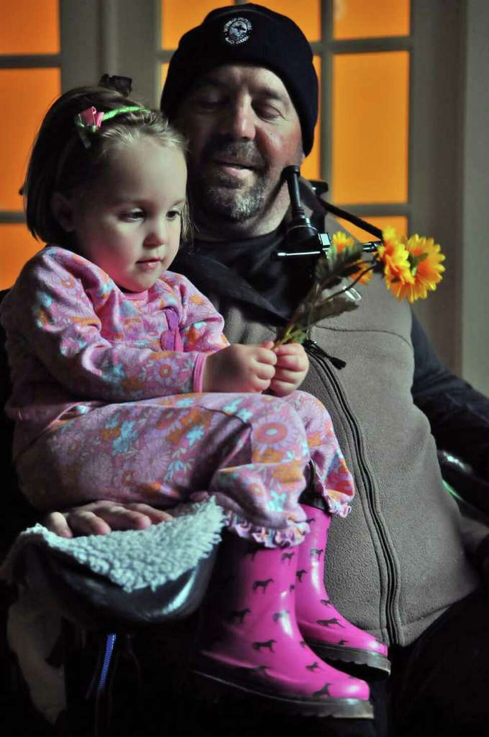 Michael Jones, a recreational rugby player who was paralyzed in February 2010, spends some time with his daughter Liliana, 3, in the kitchen of their home on Wednesday May 4, 2011 in Delmar, N.Y. (Philip Kamrass / Times Union)