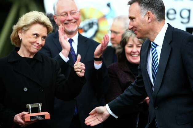 Governor Chris Gregoire gives a thumbs up to King County Executive Dow Constantine as he presents her with a piece of the old South Park bridge on Thursday, May 5, 2011 in Seattle's South Park neighborhood. Photo: JOSHUA TRUJILLO / SEATTLEPI.COM