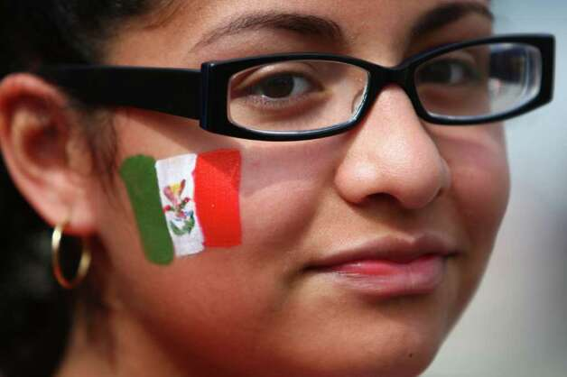 Rosalynda Romo sports a Mexican flag during a ceremony kicking off construction of a new South Park bridge on Thursday, May 5, 2011 in Seattle's South Park neighborhood. Photo: JOSHUA TRUJILLO / SEATTLEPI.COM
