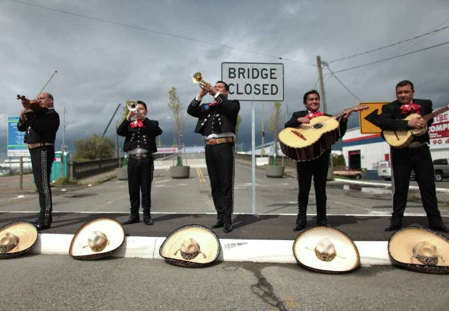 Mariachi Ayutla performs on the old South Park bridge during a celebration kicking off construction of a replacement bridge on Thursday, May 5, 2011 in Seattle's South Park neighborhood. Photo: JOSHUA TRUJILLO / SEATTLEPI.COM