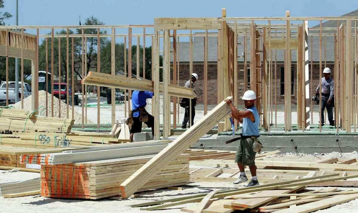 Framing crews start a house as KB Home construction continues in the Bella Vista neighborhood off Potranco Road.
