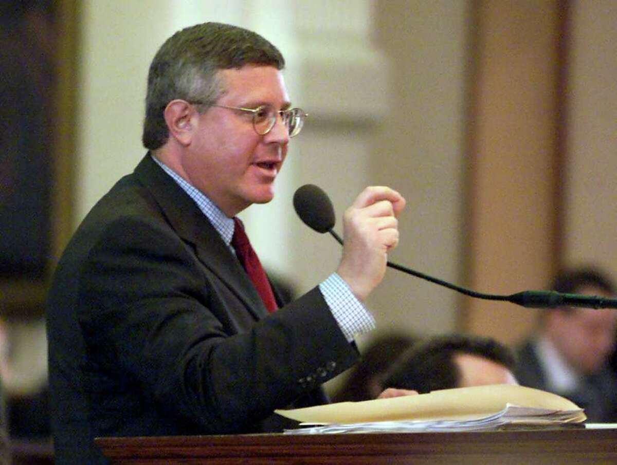 Rep. Burt Solomons, R-Carrollton, discusses details of his Texas Telecommunications Disclosure and Privacy Act at the Capitol in Austin, Texas, on Wednesday, April 4, 2001. The bill gained preliminary approval, however, a provision that would have protected the Dallas Cowboys and other businesses from class-action lawsuits was removed from the bill. (AP Photo/Deborah Cannon)