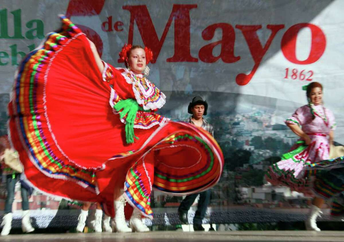 Marylin Castillo dances in Los Angeles Thursday, May 5, 2011, in honor of the Cinco de Mayo celebration.