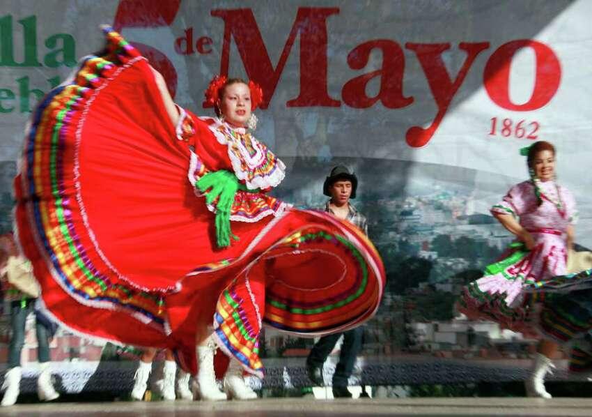 Marylin Castillo dances in Los Angeles Thursday, May 5, 2011, in honor of the Cinco de Mayo celebration.