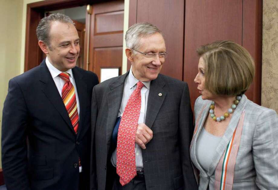 Mexico's Ambassador to the U.S. Arturo Sarukhan, left, meets with Senate Majority Leader Harry Reid of Nev. and House Minority Leader Nancy Pelosi of Calif., on Capitol Hill in Washington, Thursday, May 5, 2011, during  a Cinco de Mayo reception. Photo: AP