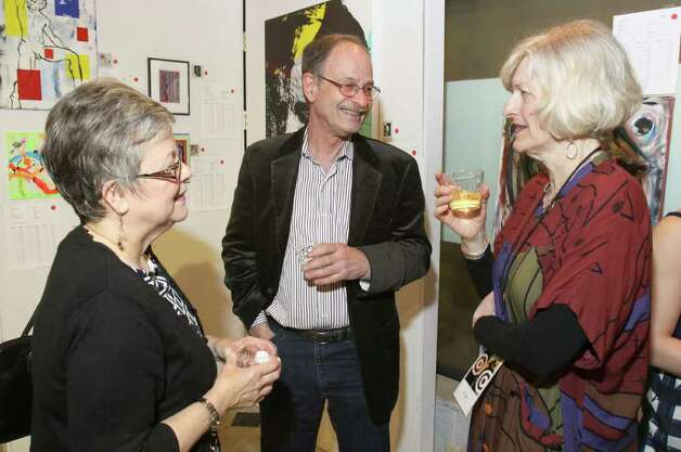 From left: Nancy Burton, Peter Leue and Linda Graf talk amid the artwork for sale at Knock It Off!, a benefit for Albany Center Gallery. Albany, NY - April 29, 2011 - (Photo by Joe Putrock / Special to the Times Union) Photo: Joe Putrock / Joe Putrock
