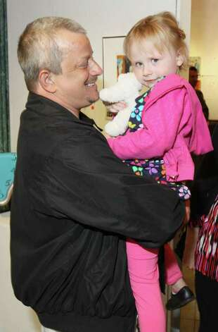 Doug Tice gives his 4-year-old granddaughter, Julianne Stone, a lift during Knock It Off!, a benefit for Albany Center Gallery. Albany, NY - April 29, 2011 - (Photo by Joe Putrock / Special to the Times Union) Photo: Joe Putrock / Joe Putrock