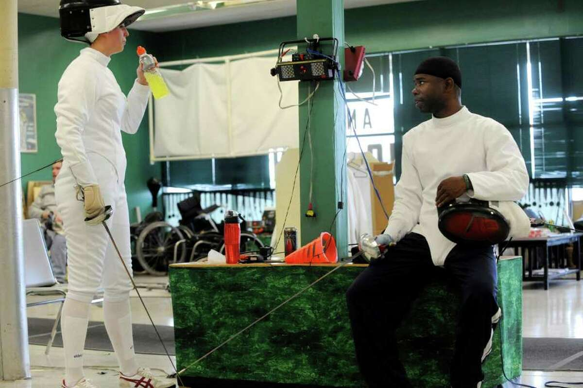 Amanda Baugher, left, who suffered serious injuries in a traffic accident, and Andre Cook, a serviceman recovering from leg wounds, take a break after fencing at the San Antonio Fencing Center. All Can Fence is an adaptive fencing program for people with disabilities. March 24, 2011. BILLY CALZADA / gcalzada@express-news.net belasco story