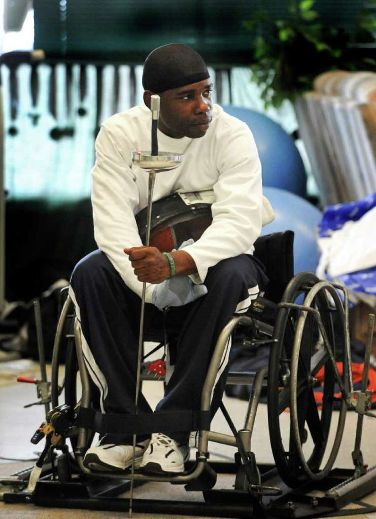 Andre Cook, a serviceman who is receiving from leg wounds suffered in service, prepares to fence at the San Antonio Fencing Center. March 24, 2011. BILLY CALZADA / gcalzada@express-news.net belasco story