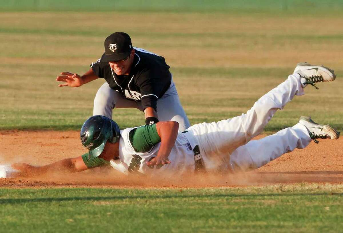Clark's Hunter McFall tags out Southwest's Felix Castillo during the first inning of the Cougar's 3-2 first round playoff victory over the Dragons at Northside Field #2 on May 5, 2011. MARVIN PFEIFFER/mpfeiffer@express-news.net