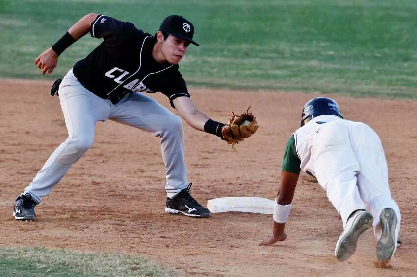 Southwest's Gerardo Rodriguez slides headfirst into second as Clark's shorstop Jason Cervantes waits to tag him out during the Cougar's 3-2 first round playoff victory over the Dragons at Northside Field #2 on May 5, 2011. MARVIN PFEIFFER/mpfeiffer@express-news.net
