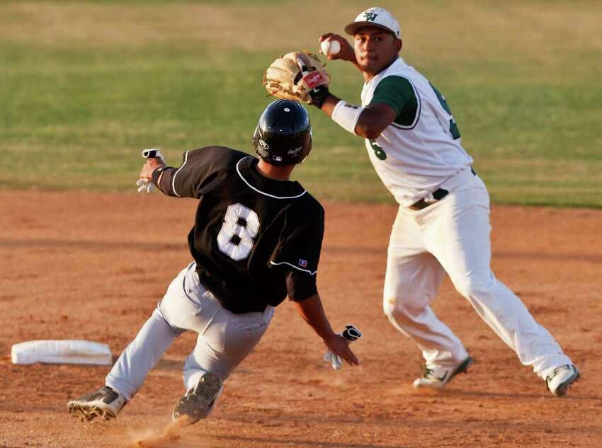 Clark's Braden Mattson slides into second as Southwest shorstop Gerardo Rodriguez throws to first after the force out during the Cougar's 3-2 first round playoff victory over the Dragons at Northside Field #2 on May 5, 2011. MARVIN PFEIFFER/mpfeiffer@express-news.net