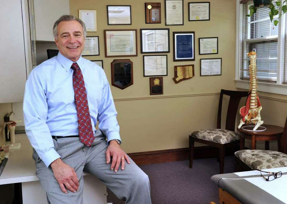 Dr. Ronald G. Manoni, a chiropractic physician, is photographed in his office on Locust Avenue in Danbury, Friday, May 6, 2011.