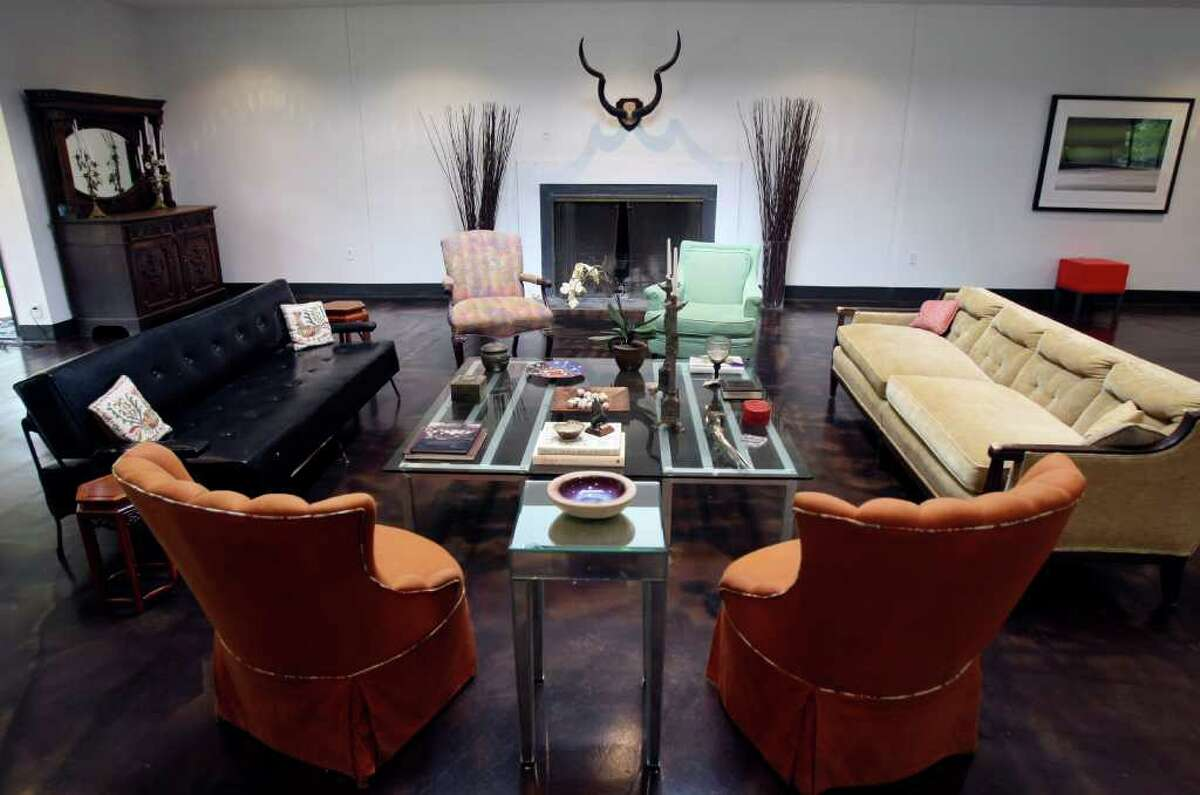 The large glass-and-steel coffee table in the living room of Kate and John Park is made of shelving from industrial kitchen freezers that she topped with a sheet of custom-cut glass.