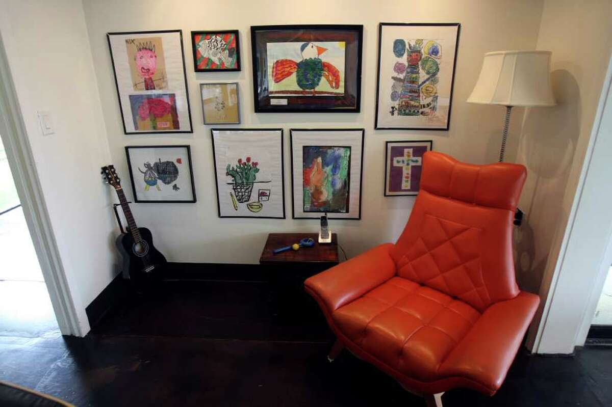 The furnishings are a mix of Mid-century furniture but also include antiques and pieces from modern retailers.