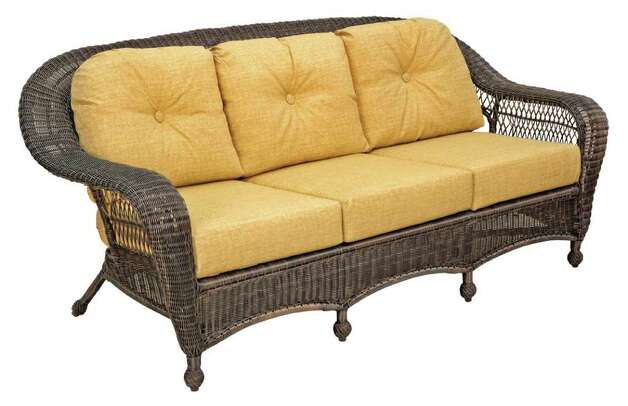 The sofa is the NCI - Aruba Cushion Aluminum Resin Wicker Sofa Includes All weather Cushions Was $1399 NOW $999.95  source: THE CHAIR KING Photo: THE CHAIR KING