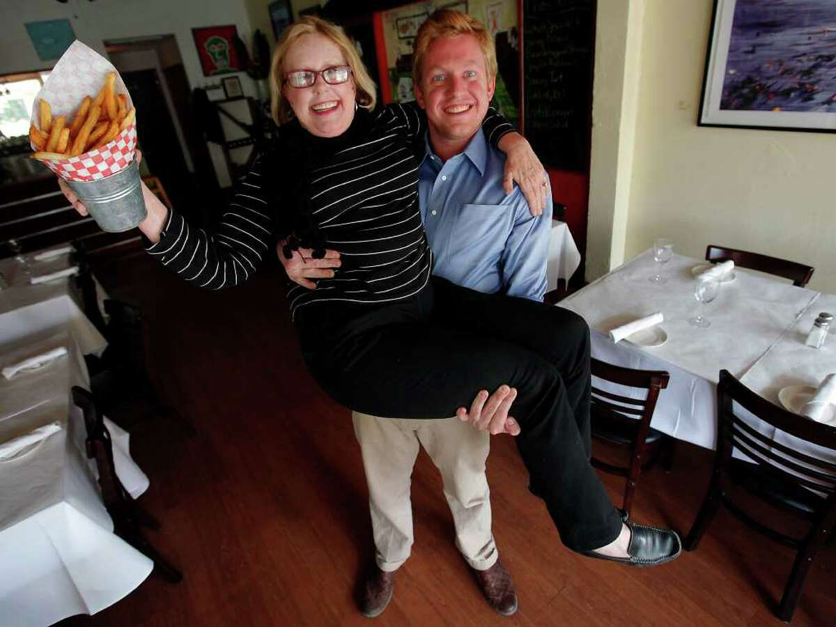 La Frite owners Icy Donnelly and her son, Miles, have fun at their restaurant located in Southtown.