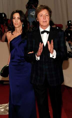 Recording artist Paul McCartney and Nancy Shevell arrive at the Metropolitan Museum of Art Costume Institute gala, Monday, May 2, 2011 in New York.  A publicist says Paul McCartney is engaged to his girlfriend of nearly four years.  Stuart Bell said Friday, May 6, that recent media speculation over a proposal is true but declined to give further details. The marriage will be McCartney's third; his first wife, Linda, died of cancer in 1998 and the rocker divorced his second wife, Heather Mills, in 2008. (AP Photo/Evan Agostini) Photo: Evan Agostini