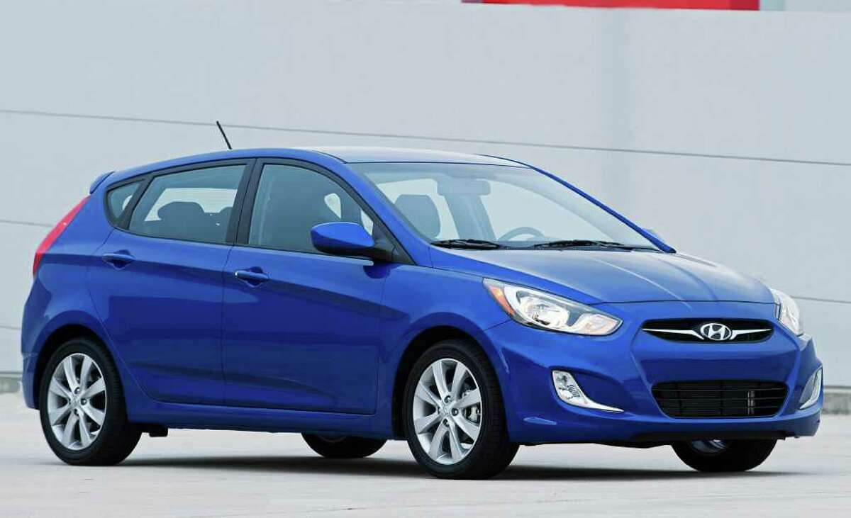 The 2012 Hyundai Accent five-door model starts at $14,595 for the base GS model with a six-speed manual gearbox and tops out at $16,795 for the SE model with a six-speed automatic transmission.