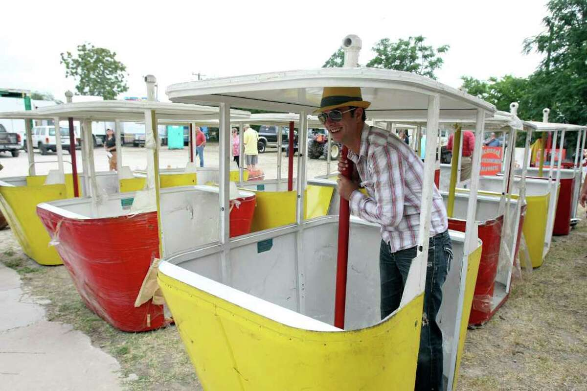 Cody McDonald poses for a photo in one of he gondolas from the first sky ride at Brackenrdige park that was auctioned on Friday. HELEN L. MONTOYA/hmontoya@express-news.net