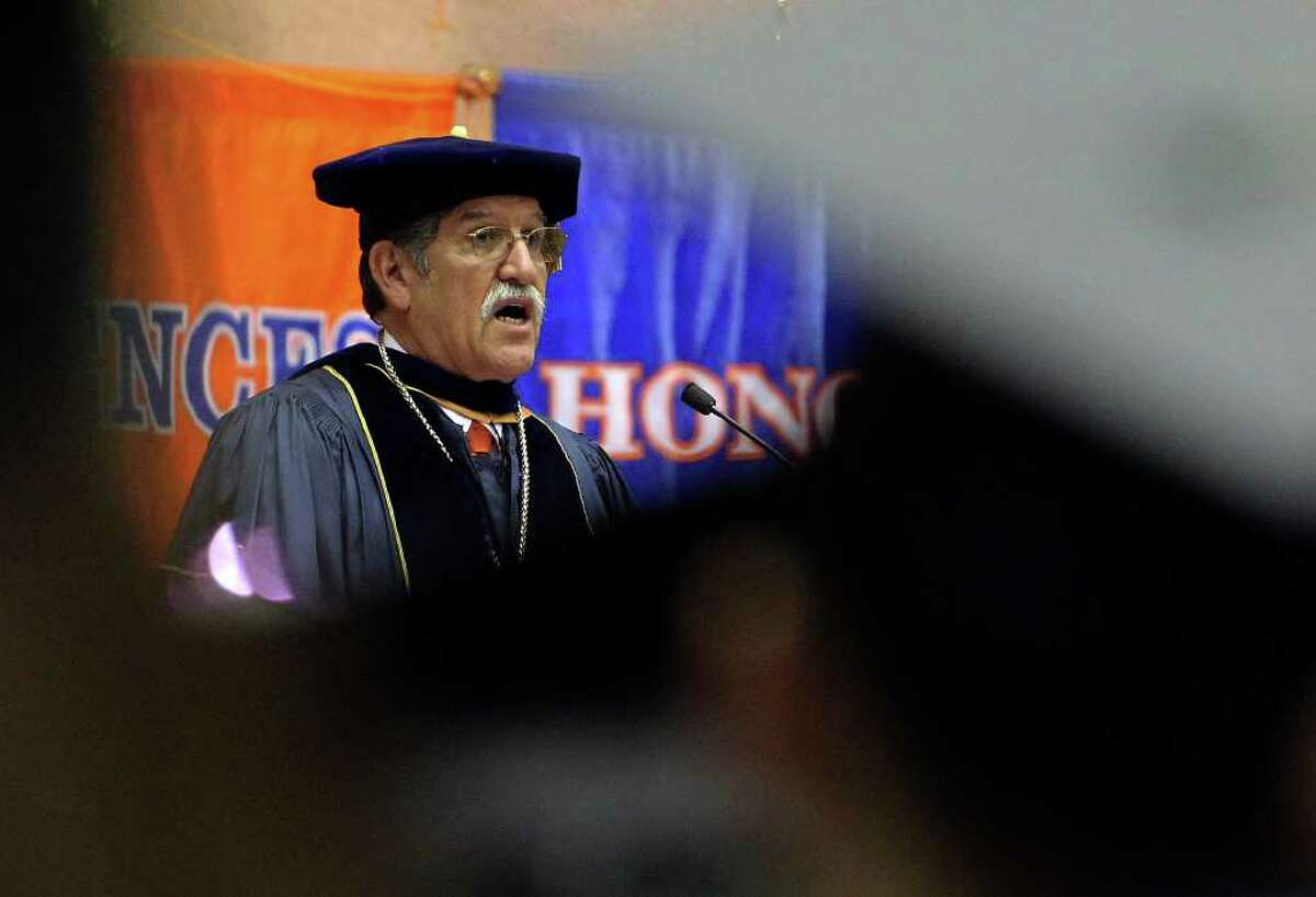 UTSA president Ricardo Romo addresses an audience during the Spring commencement ceremonies at UTSA for the College of Education and Human Development on Friday, May 6, 2011. Kin Man Hui/kmhui@express-news.net