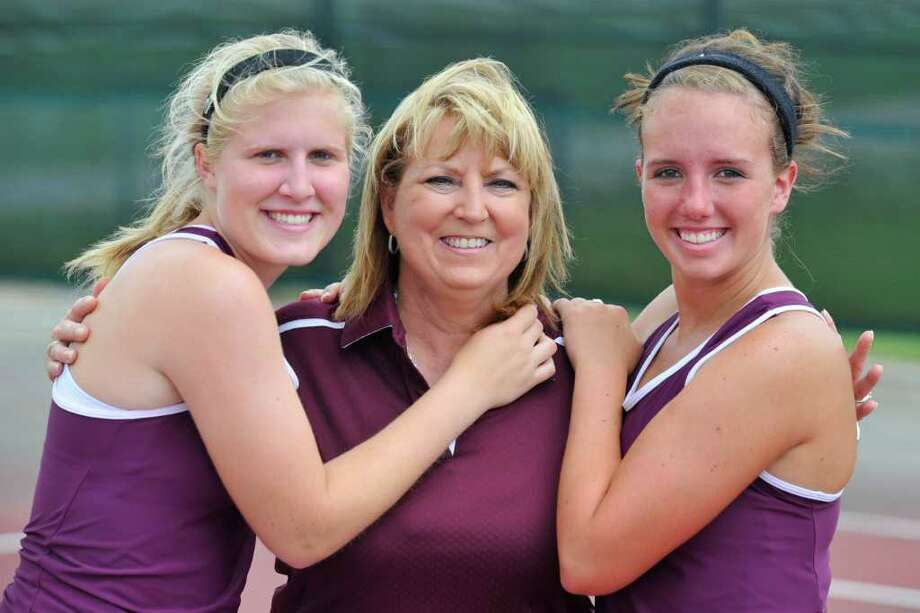 Longtime Silsbee High School tennis coach Dana Thornton, center, pictured with her girls doubles team, Katelyn Alexander, left, and Kolbie Kruft, right, who she will lead to the state tournament. It is her last shot at a title before retiring.  Tuesday, April 26, 2011.  Valentino Mauricio/The Enterprise / Beaumont