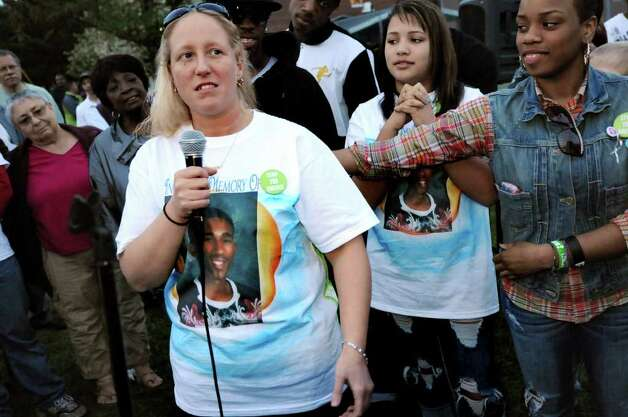 Stacey Rhodes, center, speaks during a rally held in memory of her son, Tyler, on Friday, May 6, at Hoffman Park in Albany. The Aim for Peace Rally follows the stabbing death of 17-year-old Tyler Rhodes at the park last week. (Cindy Schultz / Times Union) Photo: Cindy Schultz