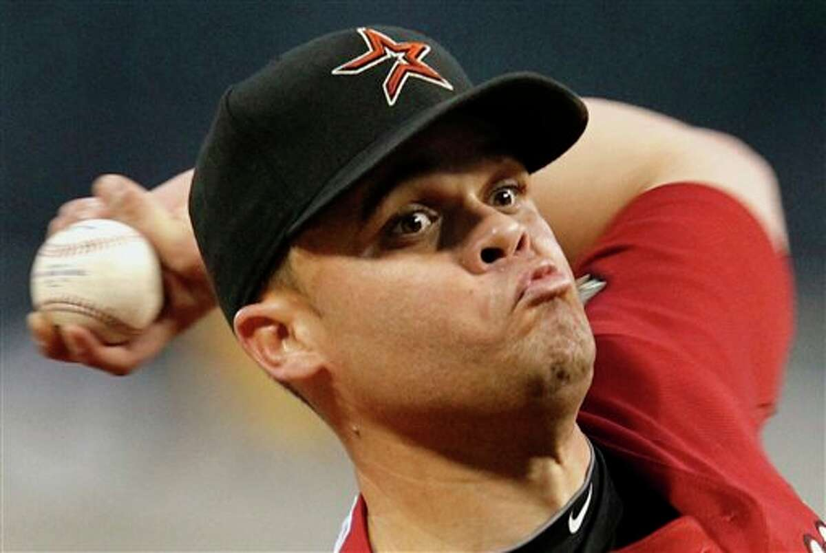 Astros pitcher Wandy Rodriguez throws in the second inning against the Pirates on Friday. GENE J. PUSKAR/ASSOCIATED PRESS