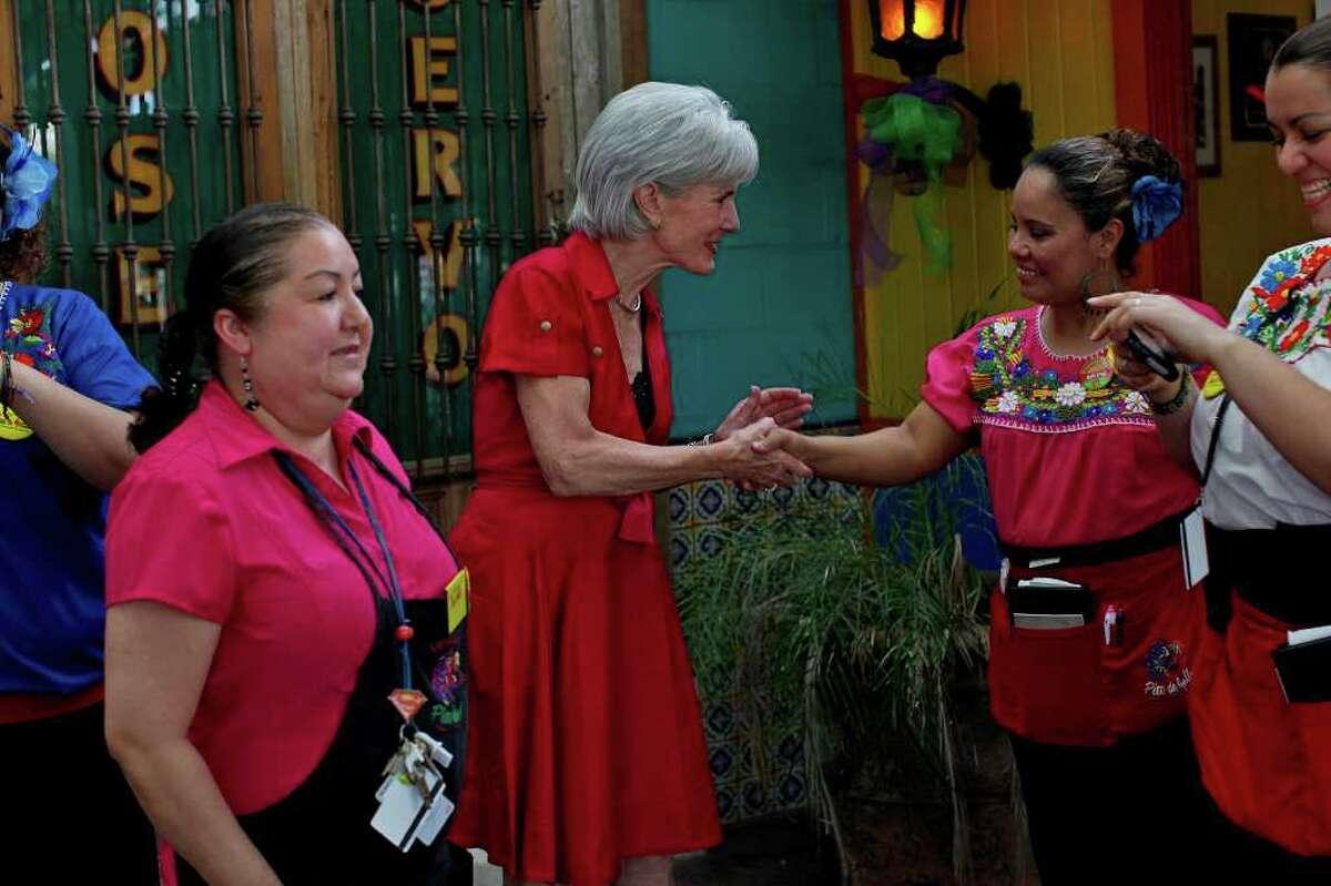 Health and Human Services Secretary Kathleen Sebelius (second from left) greets Pico De Gallo employees Lalis Lara (from left), Maria Macias and Kattia De La Cruz at a tasting. LISA KRANTZ/lkrantz@express-news.net