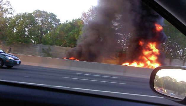 In this report-it photo sent to WTNH, a vehicle is on fire in a serious crash that happened on I-95 northbound between exits 9 and 10 in Darien, Conn. on Saturday, May 7, 2011. Photo: Contributed Photo / Connecticut Post Contributed