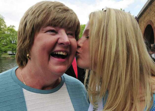 Karen Colehourof Albany Tulip Queen for 2011 gives her mother Donna a kiss at Wasington Park during Tulip Fest in Albany, NY Thursday May 7, 2011.( Michael P. Farrell/Times Union ) Photo: Michael P. Farrell