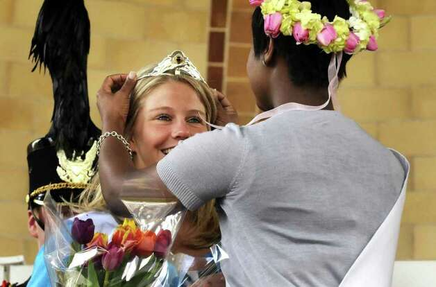 Karen Colehour of Colonie is crowned by outgoing 2010 Tulip Queen Mishks Gilkes  Albany Tulip Queen for 2011 at Wasington Park during Tulip Fest in Albany, NY Thursday May 7, 2011.( Michael P. Farrell/Times Union ) Photo: Michael P. Farrell