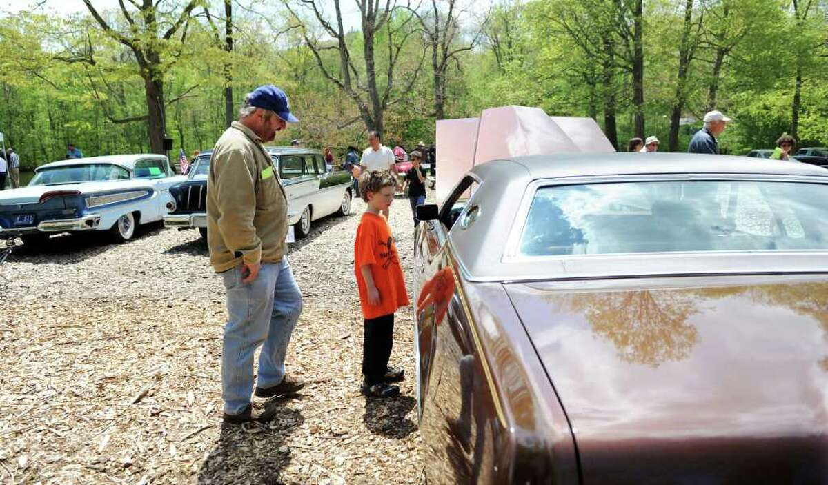 Bruce Blackwell and his son Harrison Blackwell, 8 of Brewster NY, check out a 1974 Lincoln at the 8th Annual Model Ts to Mustangs Antique and Classic Car Show at the Stamford Museum and Nature Center in Stamford, Conn. on Saturday May 7, 2011.