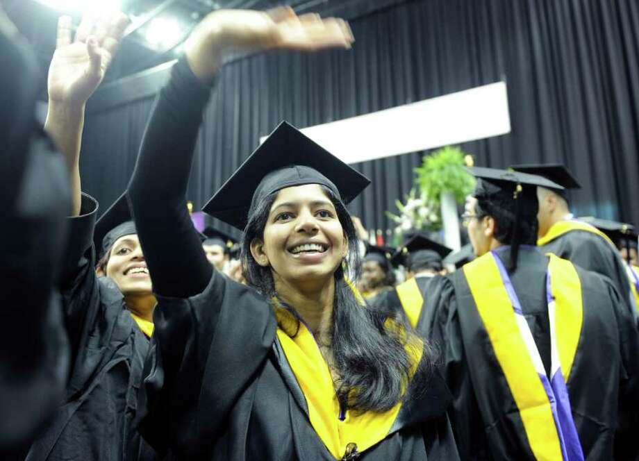 Graduate Megha Parvatikar waves to family during the University of Bridgeport's 101st commencement ceremony Saturday, May 7, 2011 at the Arena at Harbor Yard. Photo: Autumn Driscoll / Connecticut Post