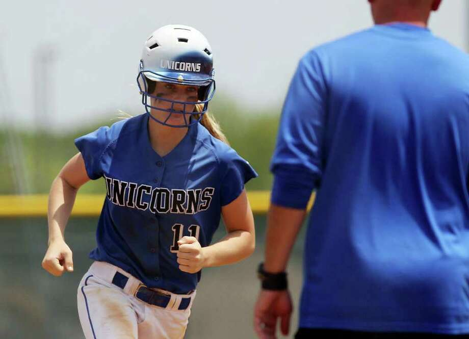 New Braunfels' Mallory Hayden rounds third base after hitting a home run in the fourth inning in softball at East Central on Saturday, May 7, 2011. New Braunfels clinched a playoff victory winning 6-2 in game 2. Kin Man Hui/kmhui@express-news.net Photo: KIN MAN HUI, : / San Antonio Express-News