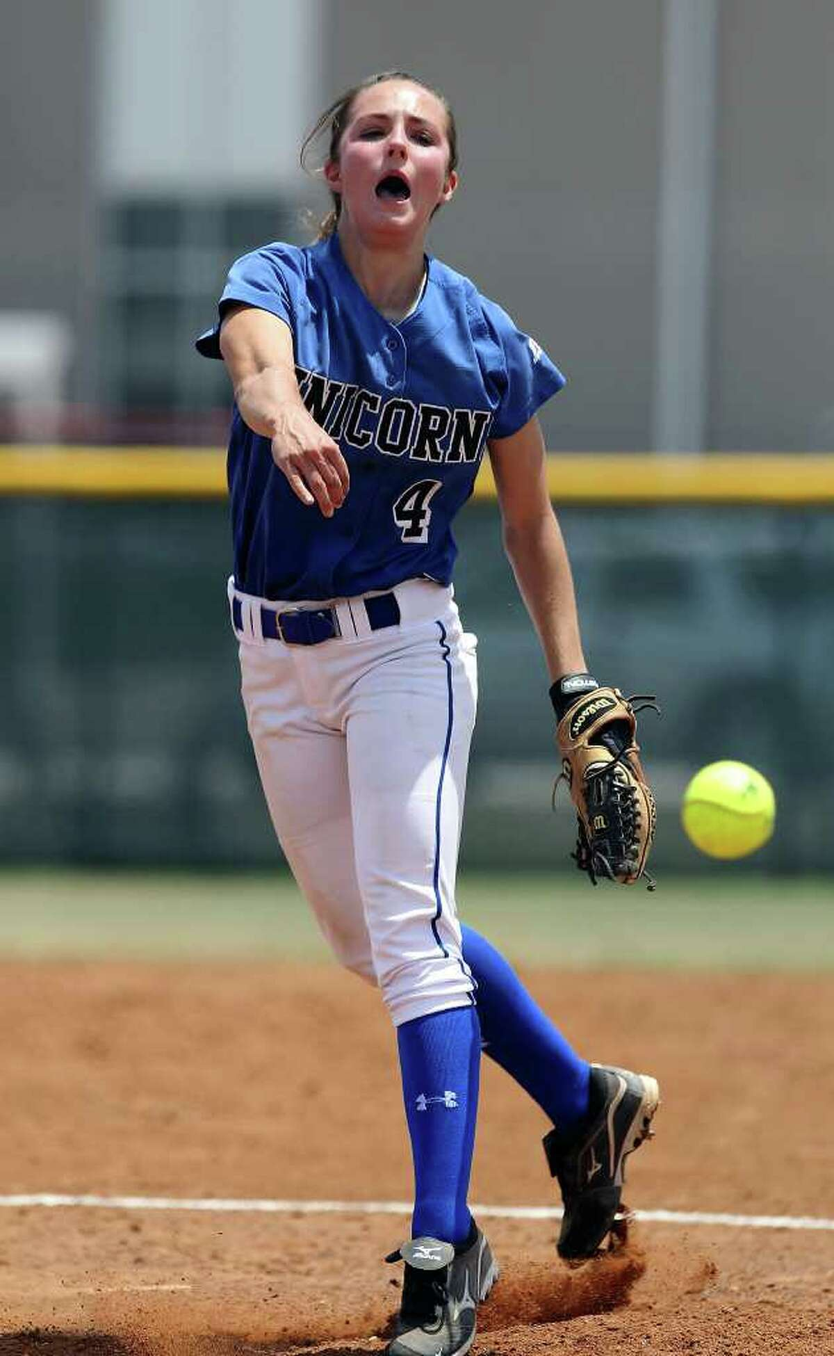 New Braunfels' pitcher Amanda Lopez fires a pitch in softball against East Central on Saturday, May 7, 2011. New Braunfels clinched a playoff victory winning 6-2 in game 2. Kin Man Hui/kmhui@express-news.net