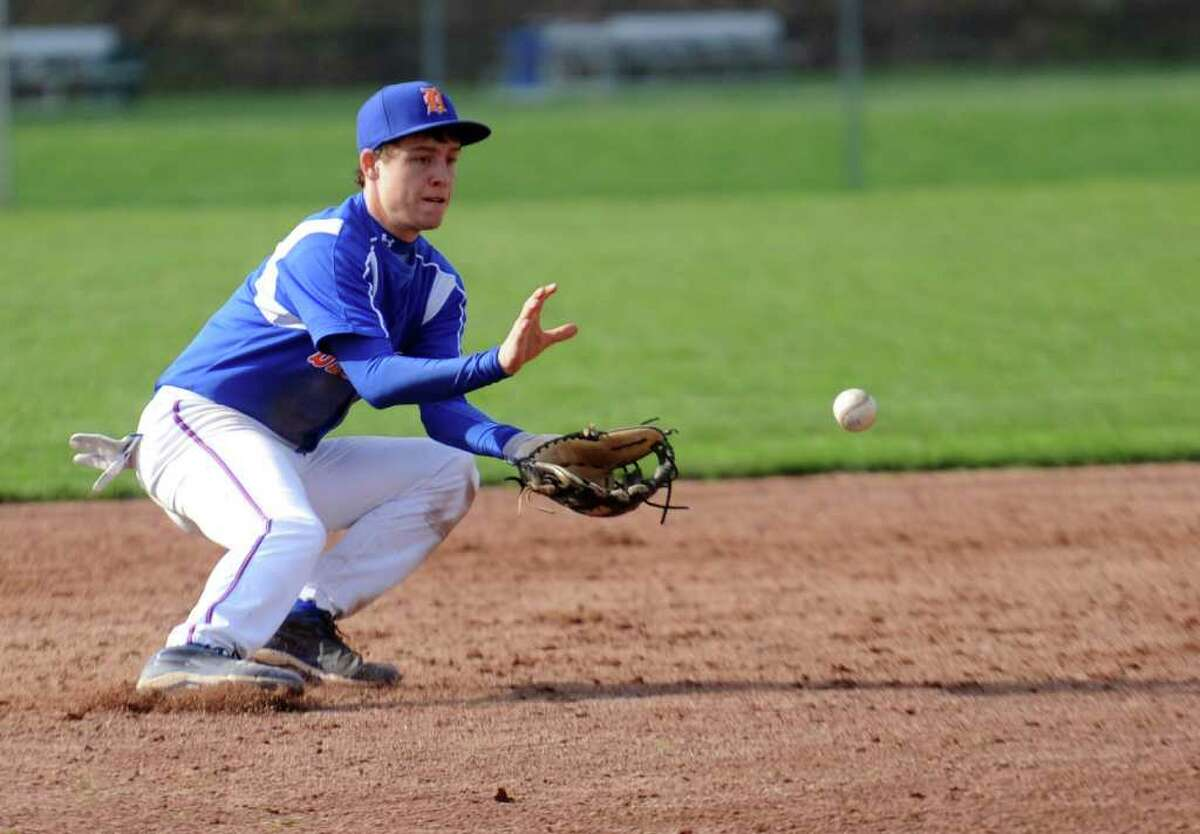 Danbury's Robbie Meerman fields the ball during Wednesday's game at Greenwich High School on April 20, 2011.