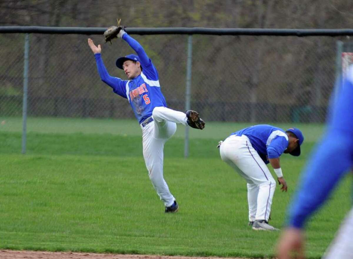Danbury's Robbie Meerman makes a catch as he dives backwards during Wednesday's game at Greenwich High School on April 20, 2011.