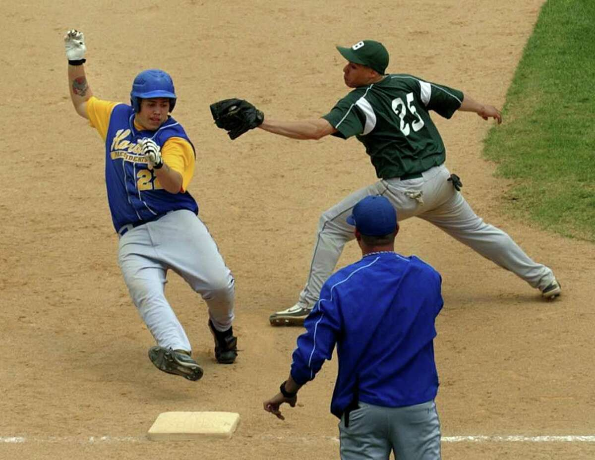 Bassick's #25 Jonathan Lopez, right, misses the tag on Harding's #22 Josh Valentine at third base, during boys baseball action at the Ballpark at Harbor Yard in Bridgeport, Conn. on Saturday May 7, 2011.