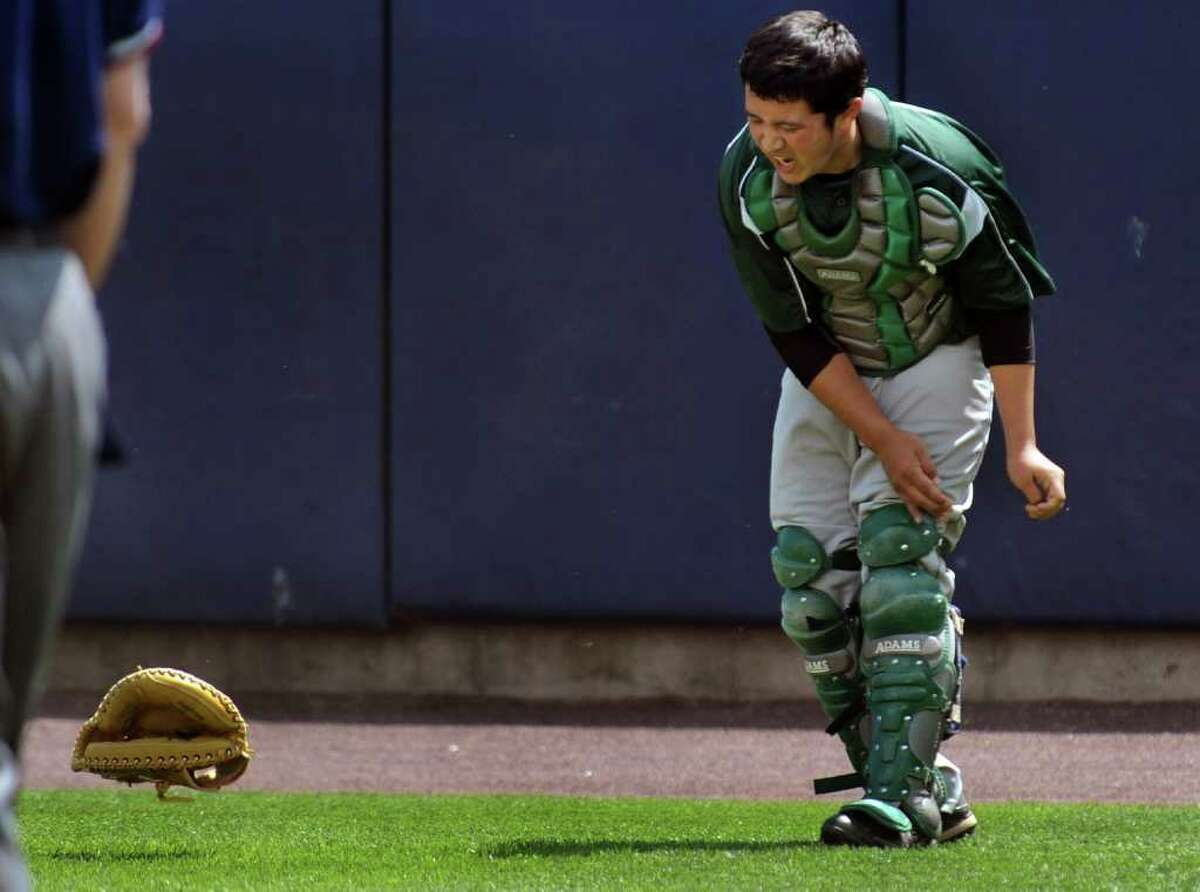 Bassick catcher Andel Ramirez throws down his glove in anger after allowing a run by Harding, during boys baseball action at the Ballpark at Harbor Yard in Bridgeport, Conn. on Saturday May 7, 2011.